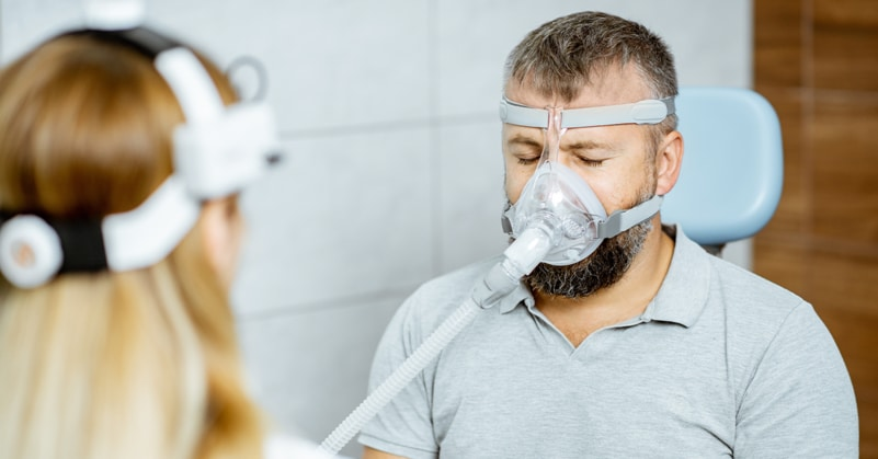 Man trying on a cpap mask