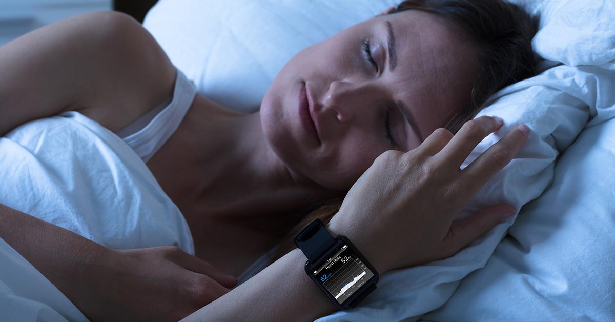 Woman Using Sleep Technology