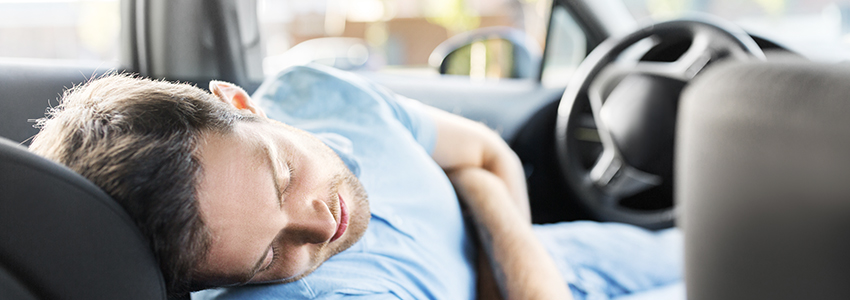 Man taking a nap in his car